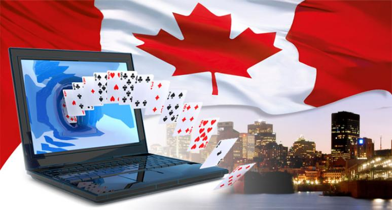 online casino canada, laptop, cards and canadian flag